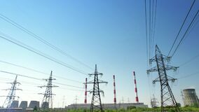 A power energy lines of high-voltage transmission pylons with heat and power plant and clear blue sky. Illustration of a