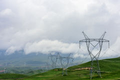 Power equipment on the Qinghai Tibet Plateau. In Qinghai Province, the electric equipment near the sun mountain scenic area is set off by the white clouds. The Royalty Free Stock Photo