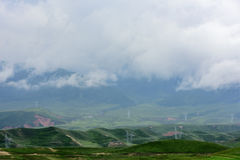 Power equipment on the Qinghai Tibet Plateau. In Qinghai Province, the electric equipment near the sun mountain scenic area is set off by the white clouds. The Royalty Free Stock Photos