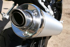 Power Exhaust. Chrome exhaust on a power motorbike royalty free stock photos