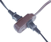 Power extension cord in use. Royalty Free Stock Image
