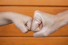 Power five, fist bump or brofist stock image