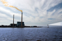 Power generating station with lighthouse Stock Photos
