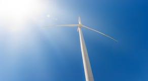 Power generating wind turbine on blue sky Royalty Free Stock Photos