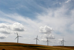 Power generating wind turbines, dramatic sky Royalty Free Stock Photography