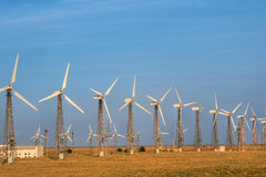 Power Generating Windmills. Wind Turbine with nature background Stock Photography
