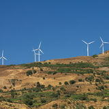 Power generating windmills. (square composition royalty free stock images