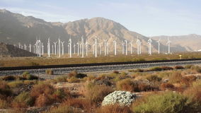 Power Generating Windmills Spin in California. Power generation in southern California Desert stock video