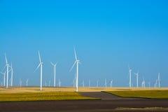 Power generating Windmills on summer landscape Royalty Free Stock Photos