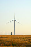 Power generating Windmills on summer landscape Stock Images