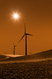 Power Generating Windmills and Sun Stock Images