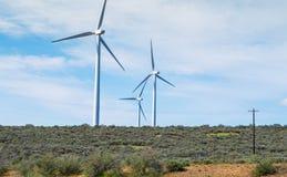 Power generating windmills Stock Photography