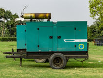 Power generator in the field. Of green grass and trees Royalty Free Stock Photography