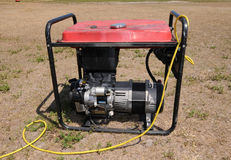 Power generator. Portable power generator running in a field Stock Photo