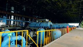 Power generator turbine. Power generator steam turbine at power plant stock video footage