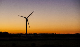 Power Generator. Power wind generator in sunset time Royalty Free Stock Photos