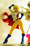 Power Girl Figurine. Realistic figurine of Power Girl comic character on a sophisticated toy and collection shop stock images