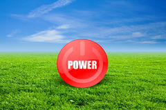 Power Green. Power button in a field of grass Royalty Free Stock Image