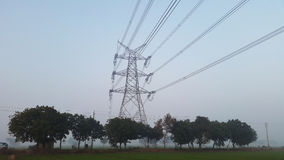 Power grid and electricity supply towers in New Delhi, India. High voltage lines connect at a power tower in the outer parts of Delhi, India Stock Image