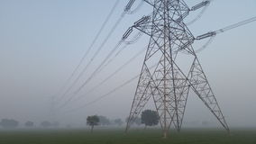 Power grid and electricity supply towers in New Delhi, India. High voltage lines connect at a power tower in the outer parts of Delhi, India Stock Photo