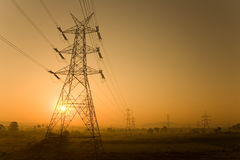 Power grid near kanakapura. Powergrid near kanakapura during a sunrise royalty free stock photography