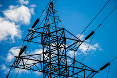 Power grid pylon. Against blue cloudy sky royalty free stock photography
