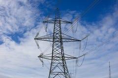 Power grid pylon on blue sky background Stock Image