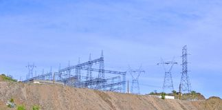Power Grid And Transmission Towers At Parker Dam. This power grid and the steel transmission towers are positioned on a flattened hill above Parker Dam. The stock photo