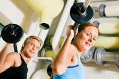 Power gymnastics with barbells Stock Photography