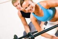 Power gymnastics with barbells Stock Image