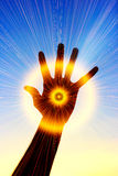 Power in hand abstract. The conceptual image of a hand which radiates rays of light Royalty Free Stock Image