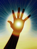 Power in a Hand. Conceptual Image of a Hand with Rays of Light Stock Photography