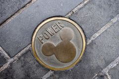 Power hole cover with Mickey Mouse imprinted. SHANGHAI, CHINA-JAN 08, 2018: Power hole cover with Mickey Mouse imprinted in Disneyland park in Shanghai, China Stock Photography