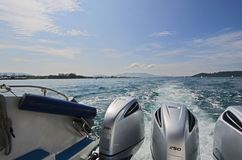 250 power horse engine of running speed boat in beautiful sea. 250 power horse engine of running speed boat in beautiful water of Andaman sea with blue sky stock photo