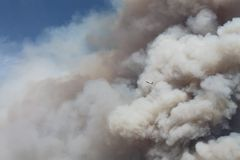 The Power House Fire ~ 2013 ~ Huge Plumes Smoke &. Photo of Huge Plumes Of Smoke & Plane. The Power House Fire in Santa Clarita California. Please check out Royalty Free Stock Image
