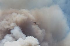 The Power House Fire ~ 2013 ~ Plane & Huge Plume O Stock Image
