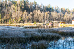 Power house by the Frosty winter lake illuminated by the rising sun. Royalty Free Stock Photography