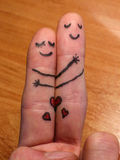 Power of hug. Concept of kindness painted on fingers: Kind beings smiling while hugging each other and feeling love together stock images
