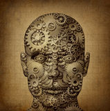 Power Of Human Creativity. With a front facing head made of gears and cogs on a grunge old parchment texture as a symbol of ingenuity and business or health Royalty Free Stock Photo