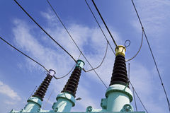 Power isolators. High voltage power isolators against blue sky with clouds Royalty Free Stock Photos