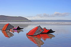 Power Kites on a Beach. Kites reflected in Westward Ho Beach Stock Images