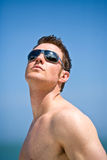 Power of life. Young handsome Caucasian man with sunglasses Stock Photo