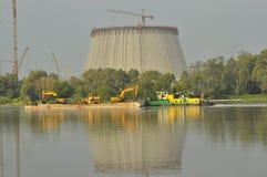 Power lights. Chimneys launching smoke. Cranes, extending the electron. Heat generation. Stock Photos