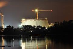 Power lights illuminated at night. Chimneys launching smoke. Cranes, extending the electron. Heat generation. Royalty Free Stock Photos