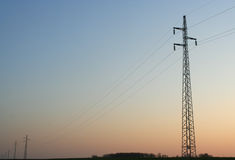 Power line. Against a sunset sky royalty free stock photography
