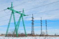 Power line. Field, blue sky and green power line Stock Photo