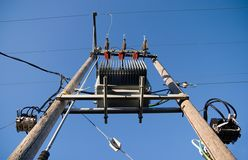 Power line. On blue background Stock Photos