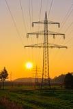 Power Line. With illuminating sunset Stock Images