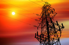 Power line. High-voltage tower silhouette dusk stock photo