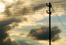 Power line. Powerline with dark clouds of a upcoming thunderstorm in the background stock image